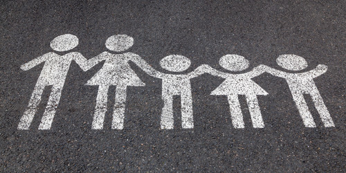 two adults and three children are drawn with chalk on the street